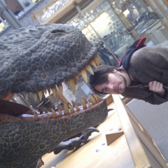 Jack being 'eaten' by a T-Rex at the Oxford Natural History Museum